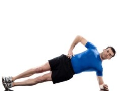 man lying on side Abdominals workout posture on studio isolated white background
